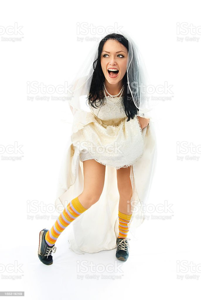 excited young bride wearing sporting shoes royalty-free stock photo