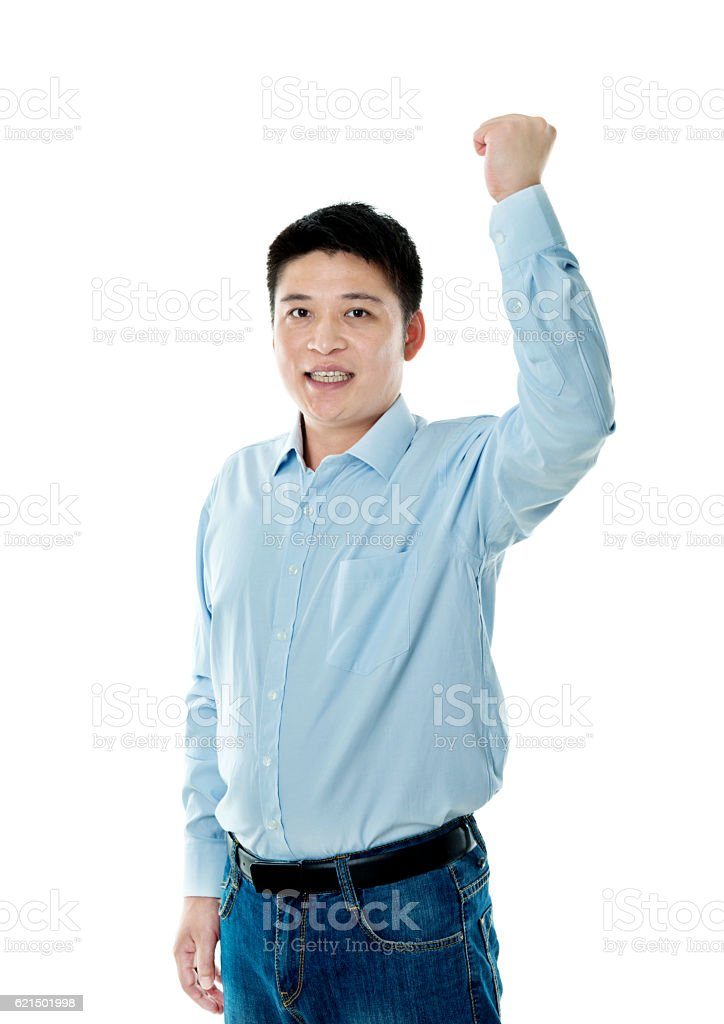 Excited young businessman cheering stock photo