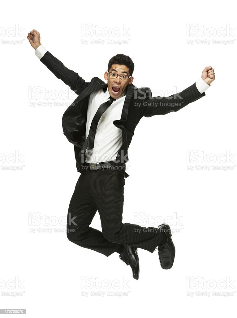 Excited young businessman jumping in joy royalty-free stock photo