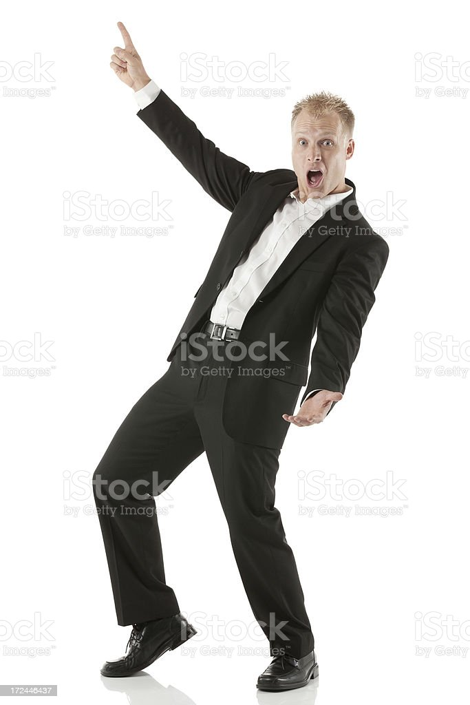 Excited young businessman pointing royalty-free stock photo