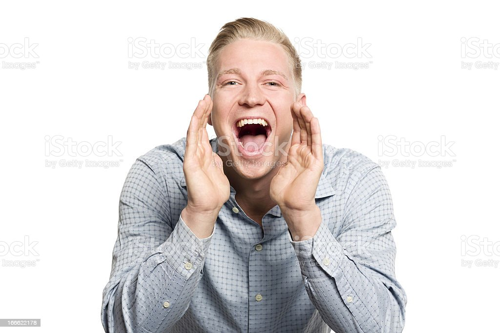 Excited young businessman shouting great news. royalty-free stock photo