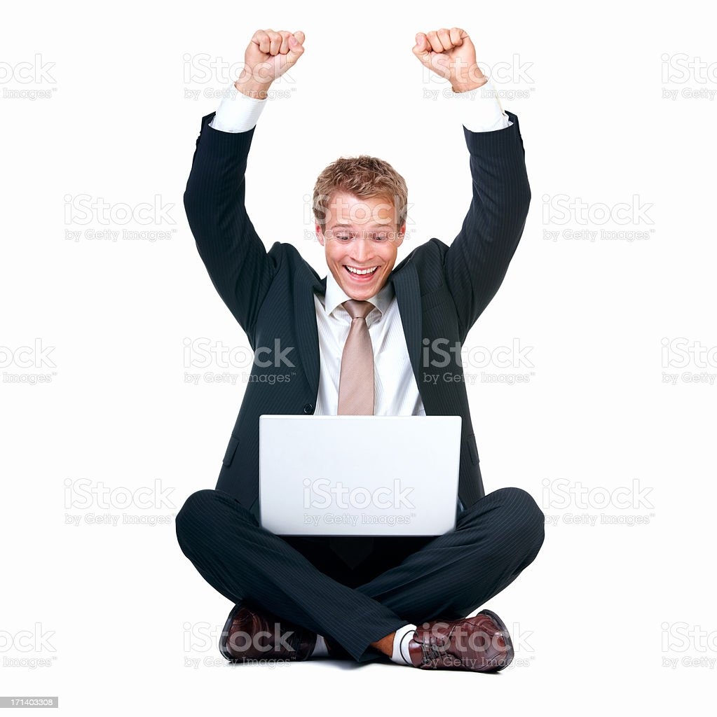 Excited young businessman with hands raised using laptop royalty-free stock photo