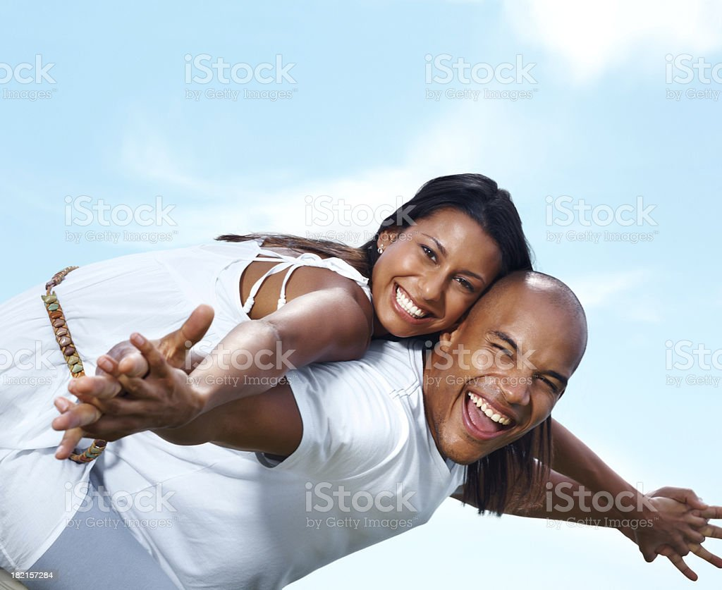 Excited young couple enjoying the sun royalty-free stock photo