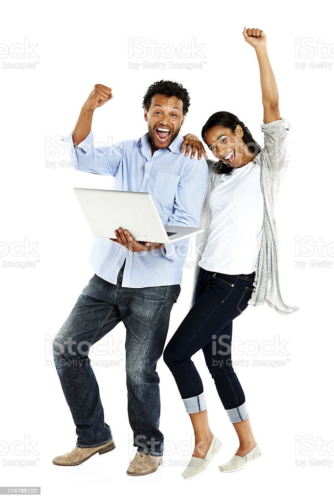 Excited young couple with a laptop royalty-free stock photo