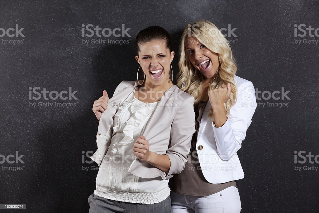 Excited young female friends stock photo