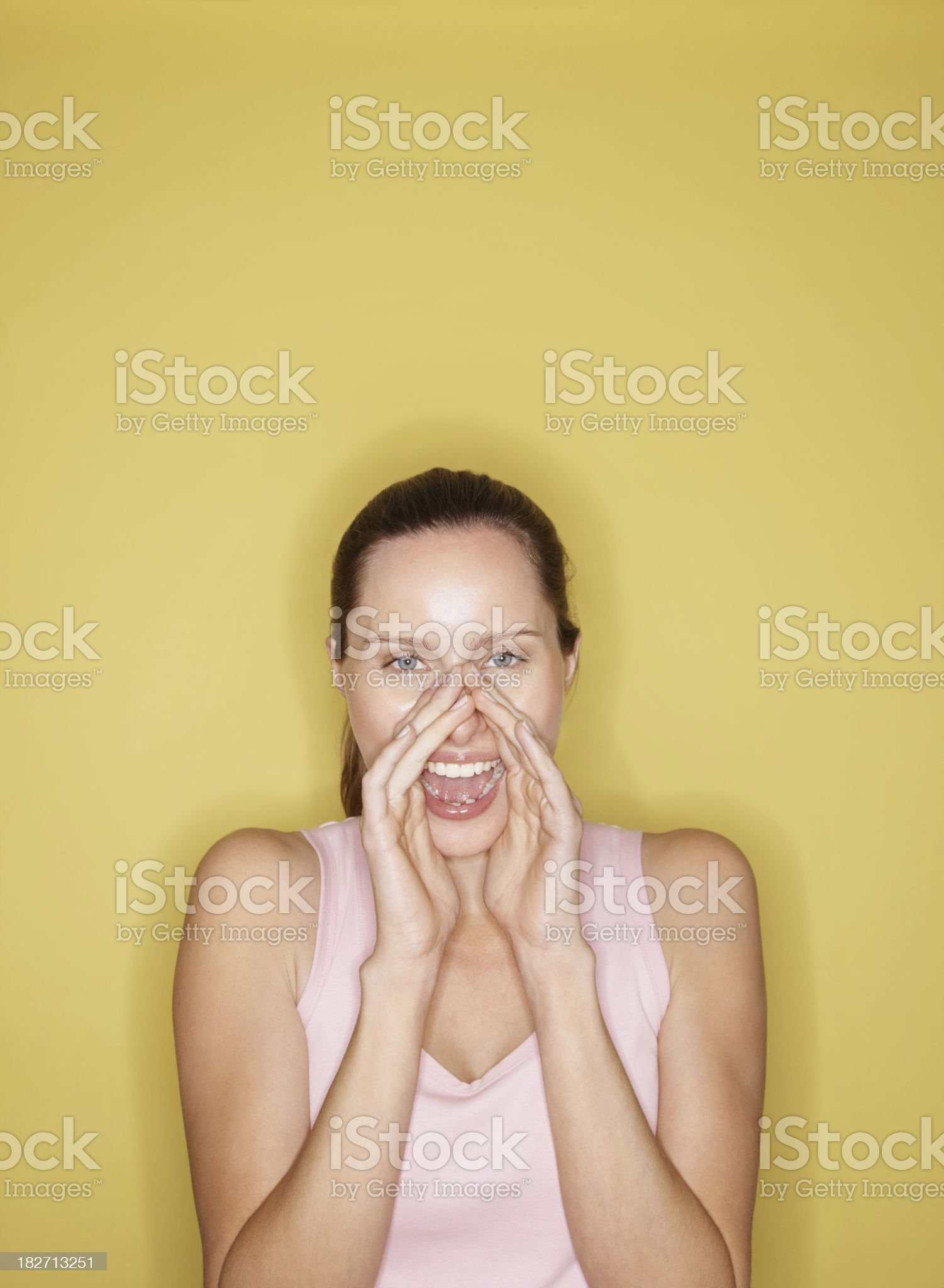 Excited young female isolated against yellow background royalty-free stock photo