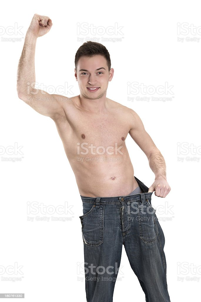 Excited Young Fit Man Showing Amount of Weight He Lost royalty-free stock photo