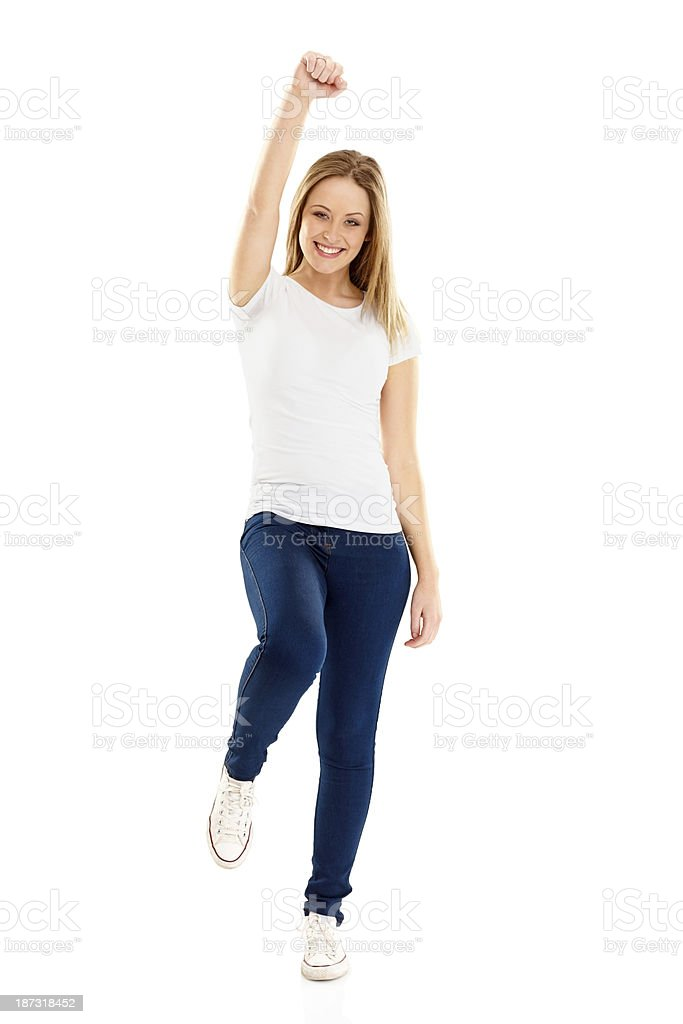 Excited young girl cheering on white royalty-free stock photo