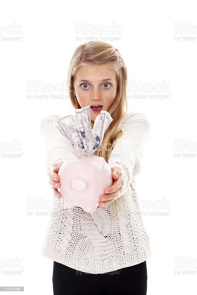 Excited young girl holding piggy bank full of money royalty-free stock photo