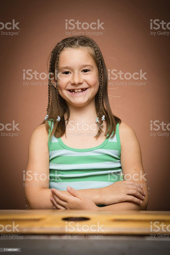 Excited Young Girl Student Sitting at School Desk royalty-free stock photo