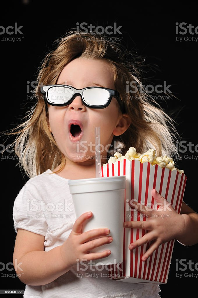 Excited Young Girl with 3D Glasses Theater Popcorn and Drink royalty-free stock photo