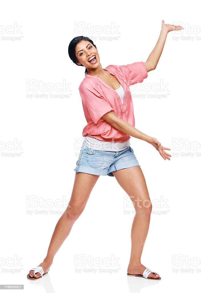 Excited young lady showing your product at copyspace stock photo