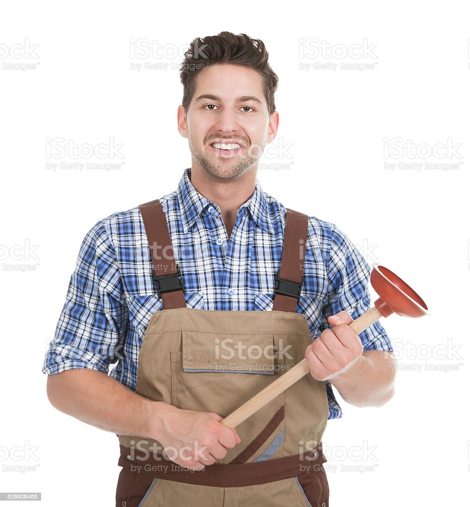 Excited Young Male Plumber Holding Plunger stock photo