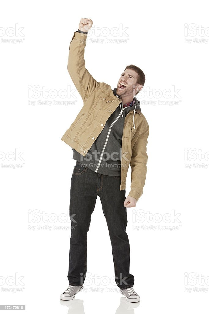 Excited young man celebrating his success royalty-free stock photo