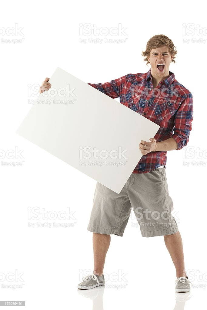 Excited young man holding a placard royalty-free stock photo
