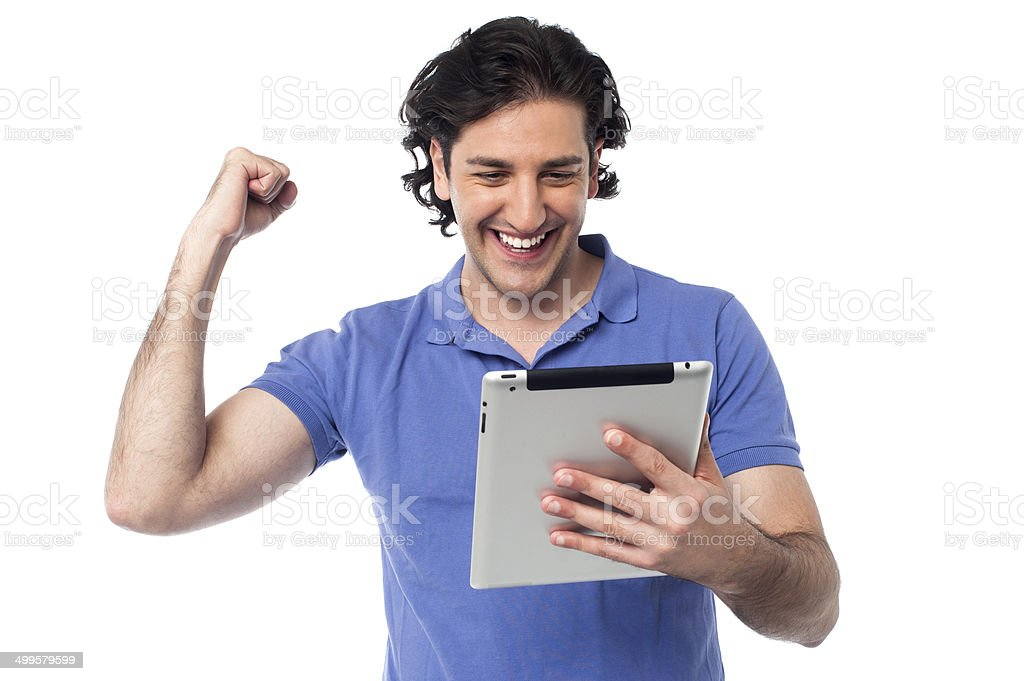 Excited young man holding touch pad device royalty-free stock photo