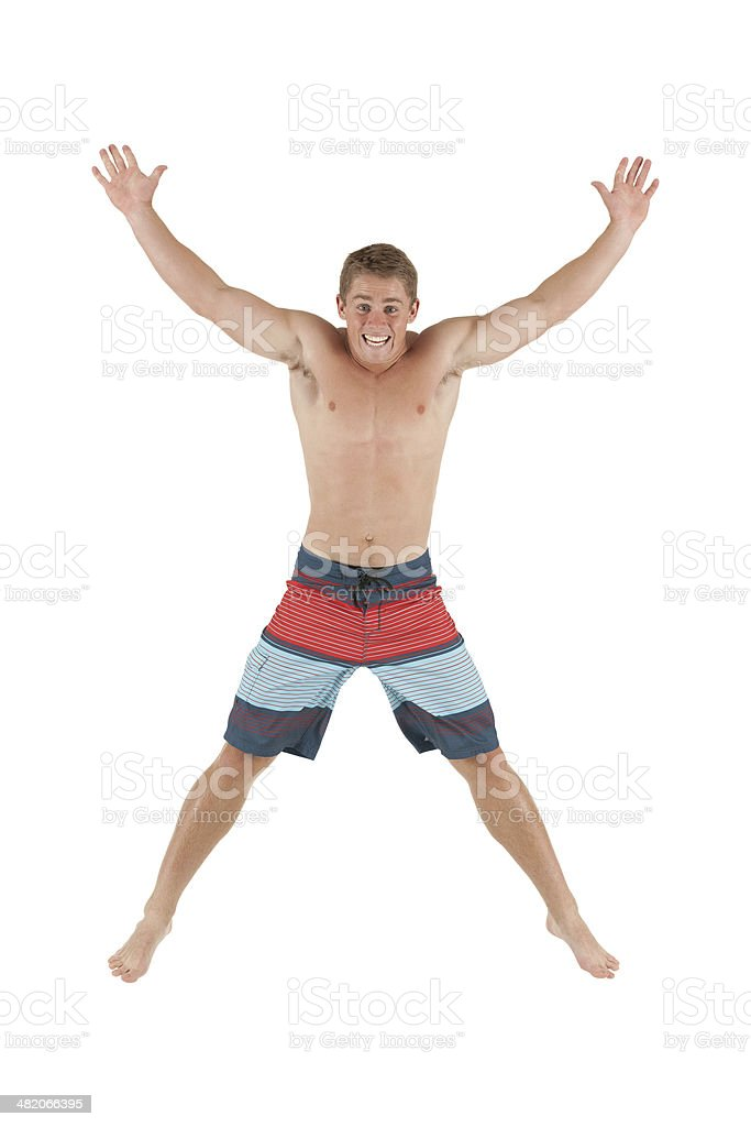 Excited young man jumping royalty-free stock photo