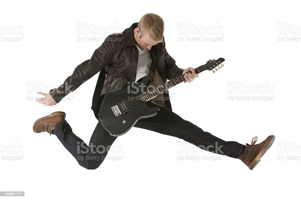 Excited young man playing a guitar royalty-free stock photo