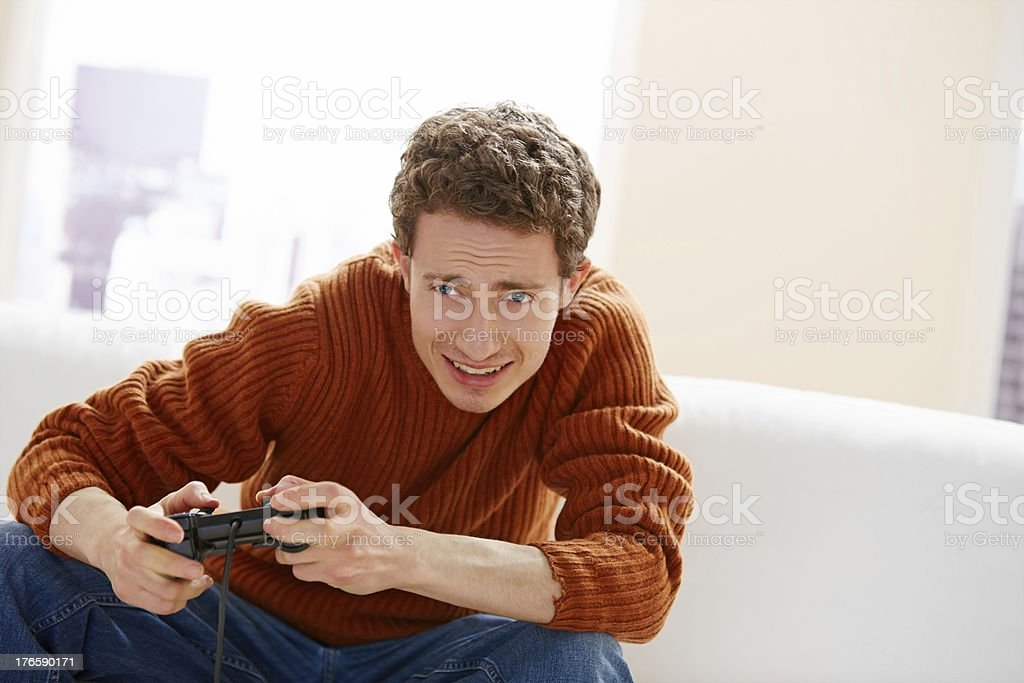 Excited young man playing video game at home royalty-free stock photo