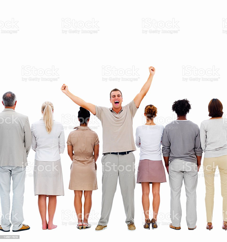 Excited young man standing between colleagues in a row royalty-free stock photo