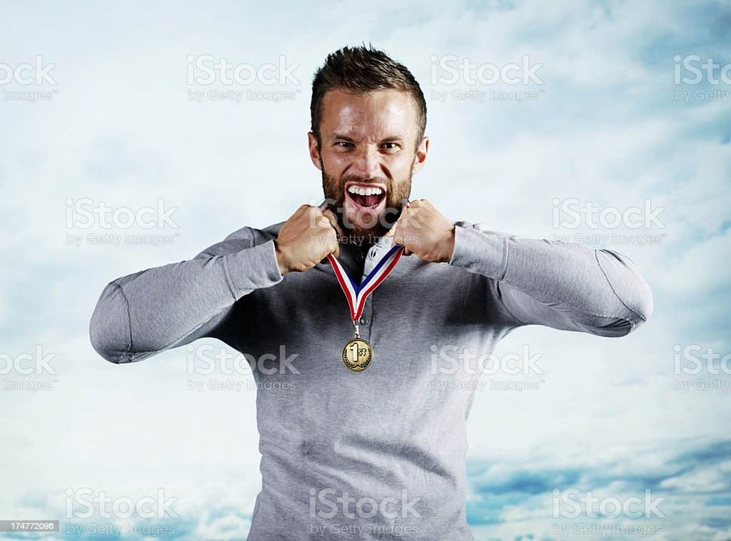 Excited young man with his medal. royalty-free stock photo