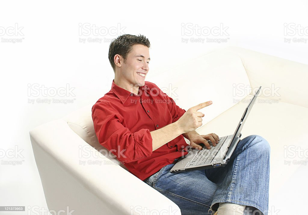 Excited young man with laptop royalty-free stock photo