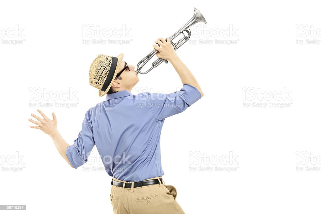 Excited young musician playing trumpet royalty-free stock photo