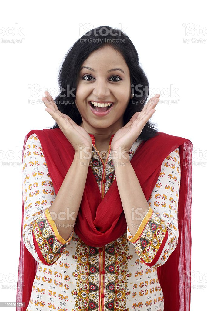 Excited young woman against white background stock photo