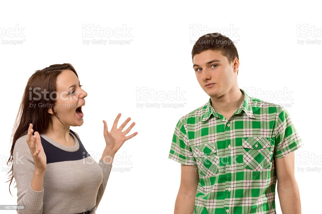 Excited young woman gesturing at her boyfriend stock photo