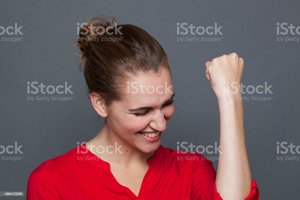 excited young woman gesturing to express fun excitement stock photo