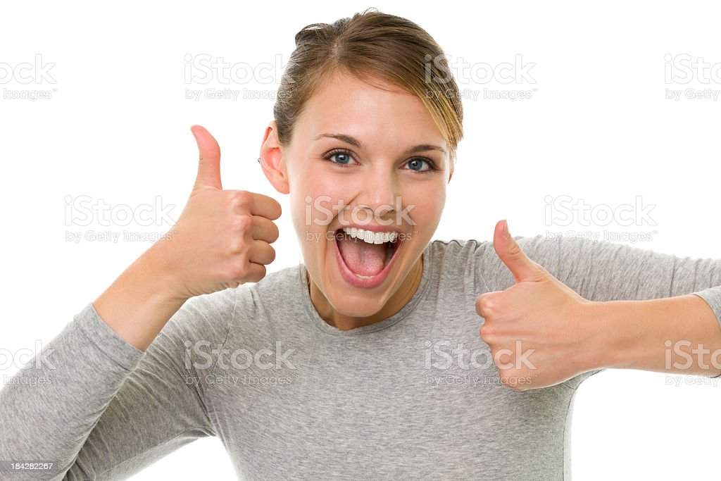 Excited Young Woman Gives Two Thumbs Up stock photo