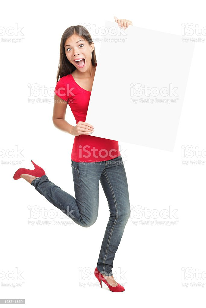 Excited young woman holding empty white board royalty-free stock photo