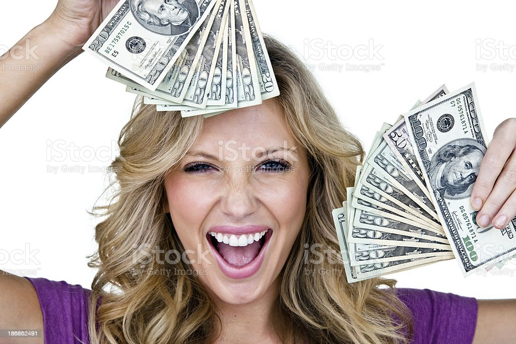 Excited young woman holding money stock photo