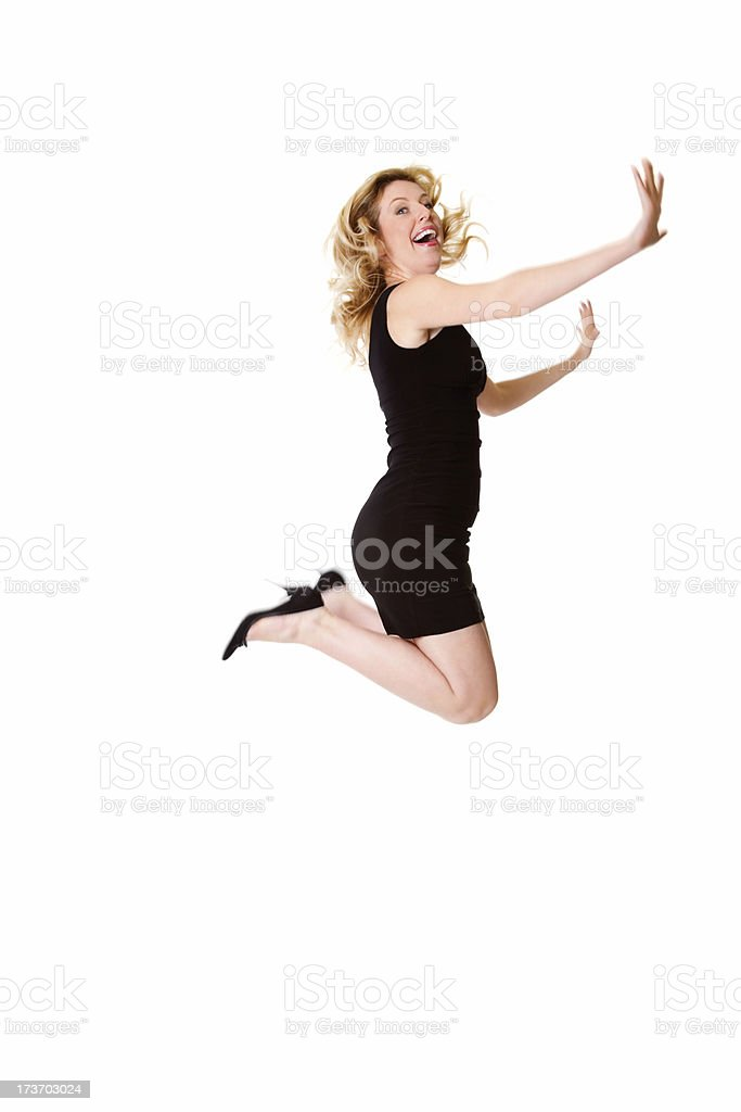 Excited young woman jumping legs folded and hands raised royalty-free stock photo