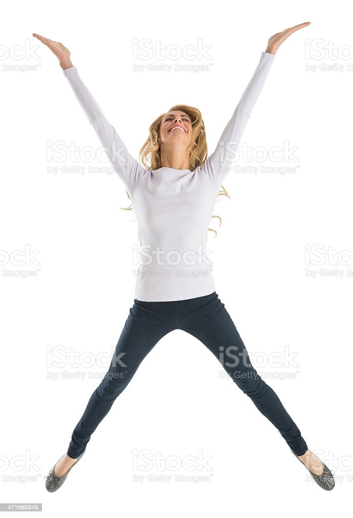 Excited Young Woman Jumping stock photo