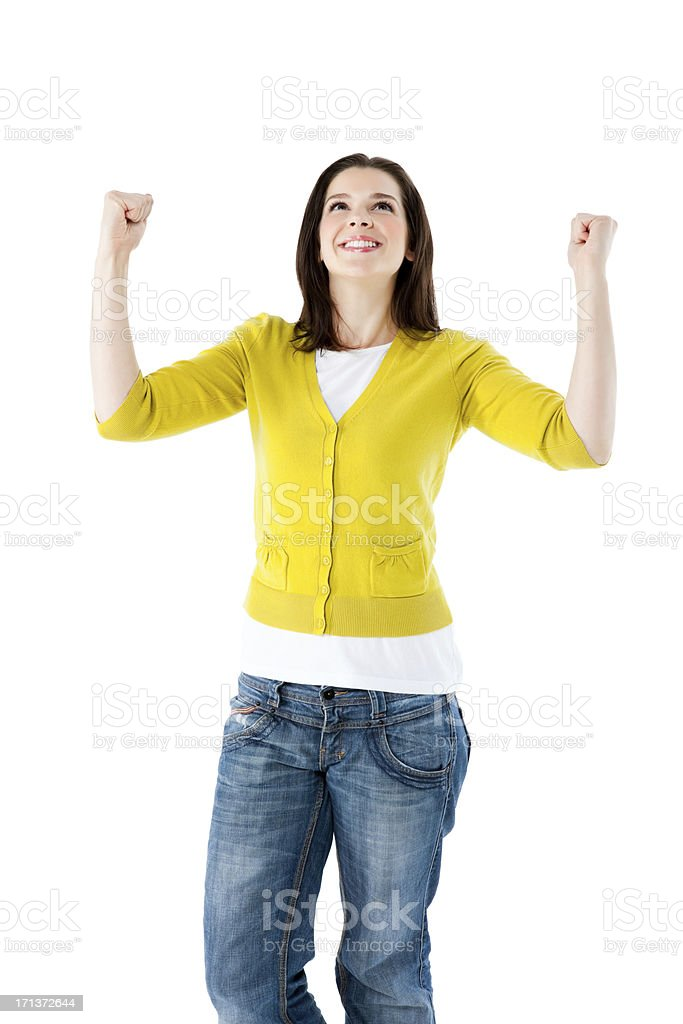 Excited young woman looking up with her arms raised royalty-free stock photo