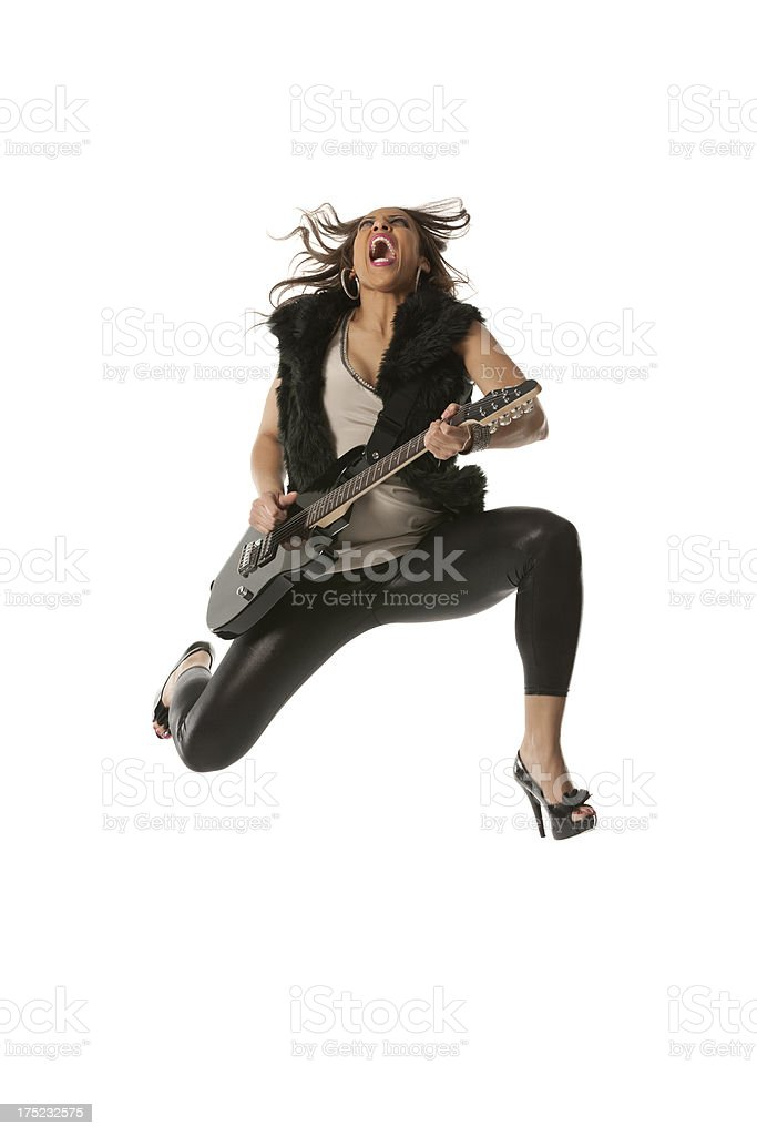 Excited young woman playing guitar royalty-free stock photo