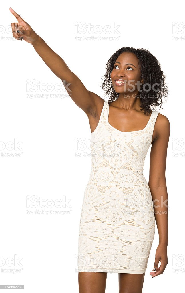 Excited Young Woman Pointing And Looking Up royalty-free stock photo