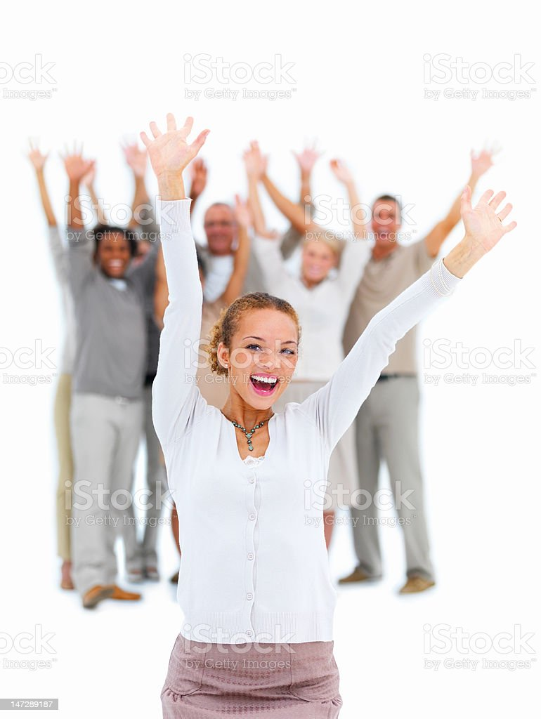 Excited young woman raising her hands royalty-free stock photo
