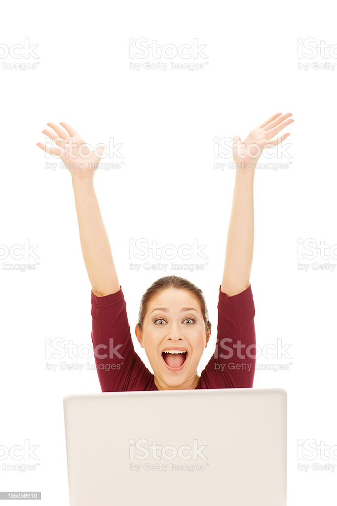 Excited Young Woman using laptop royalty-free stock photo