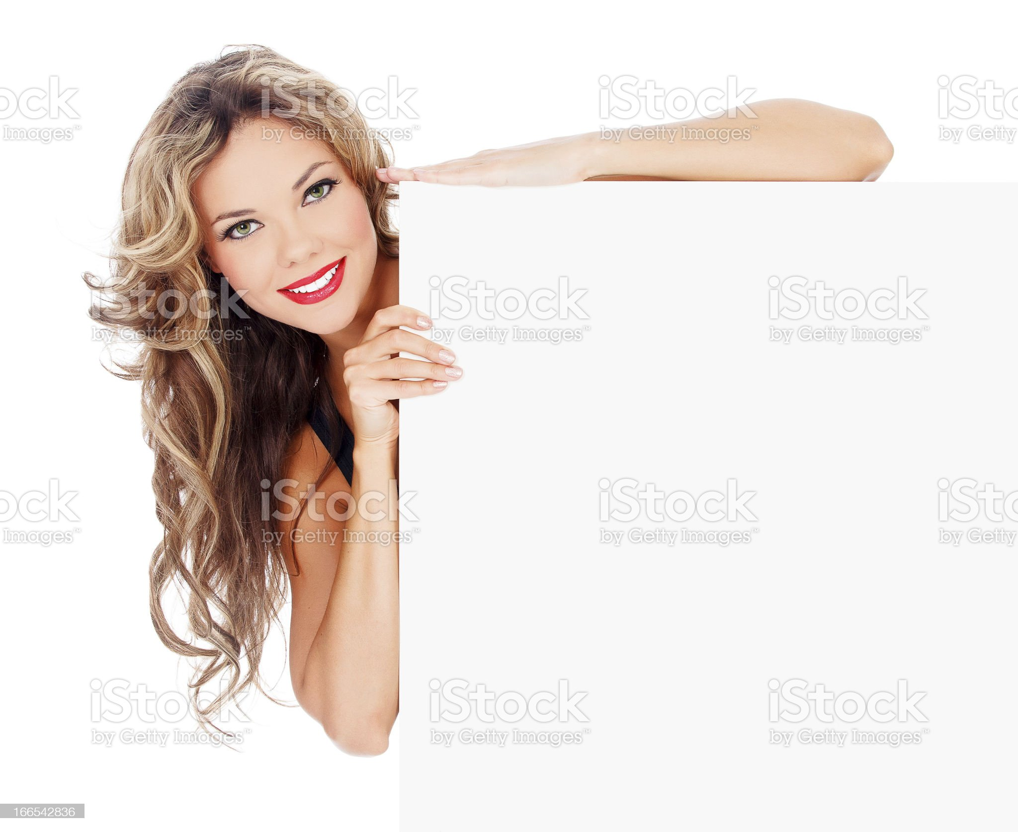 Excited young woman with a blank billboard royalty-free stock photo