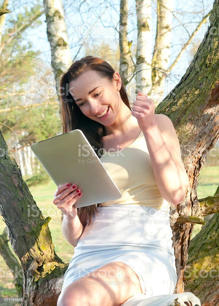 excited young woman with tablet pc royalty-free stock photo