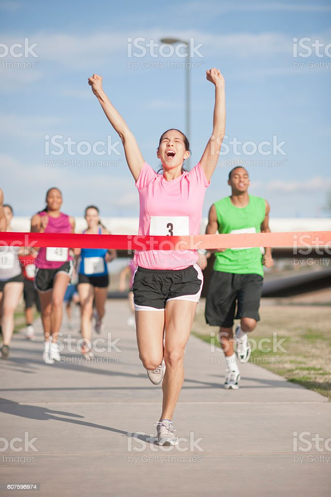 Excitedly Crossing the Finish Line stock photo