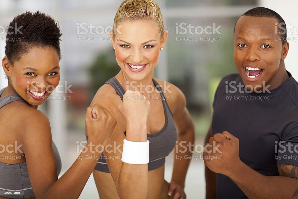 exciting fit people waving fist royalty-free stock photo