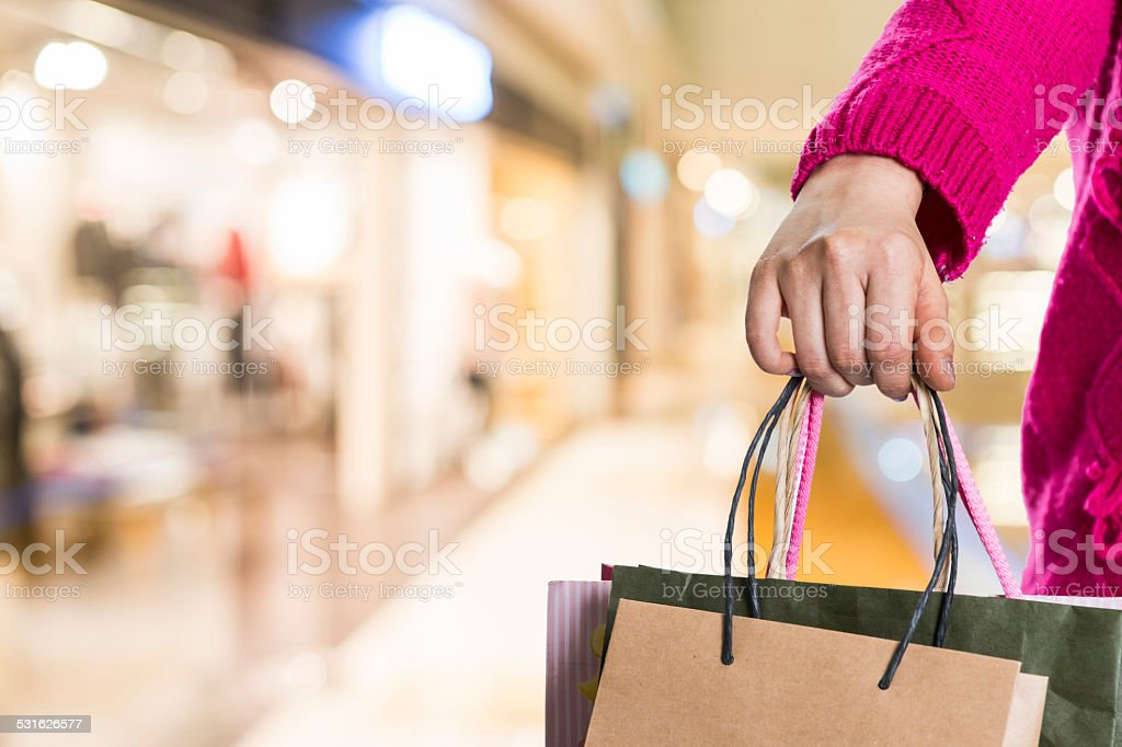 Exciting young shopping woman hold bags, closeup portrait with copyspace. stock photo