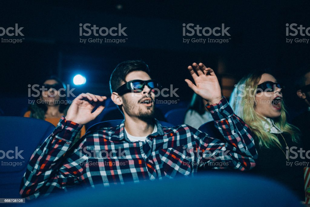 Excitment of people in cinema stock photo
