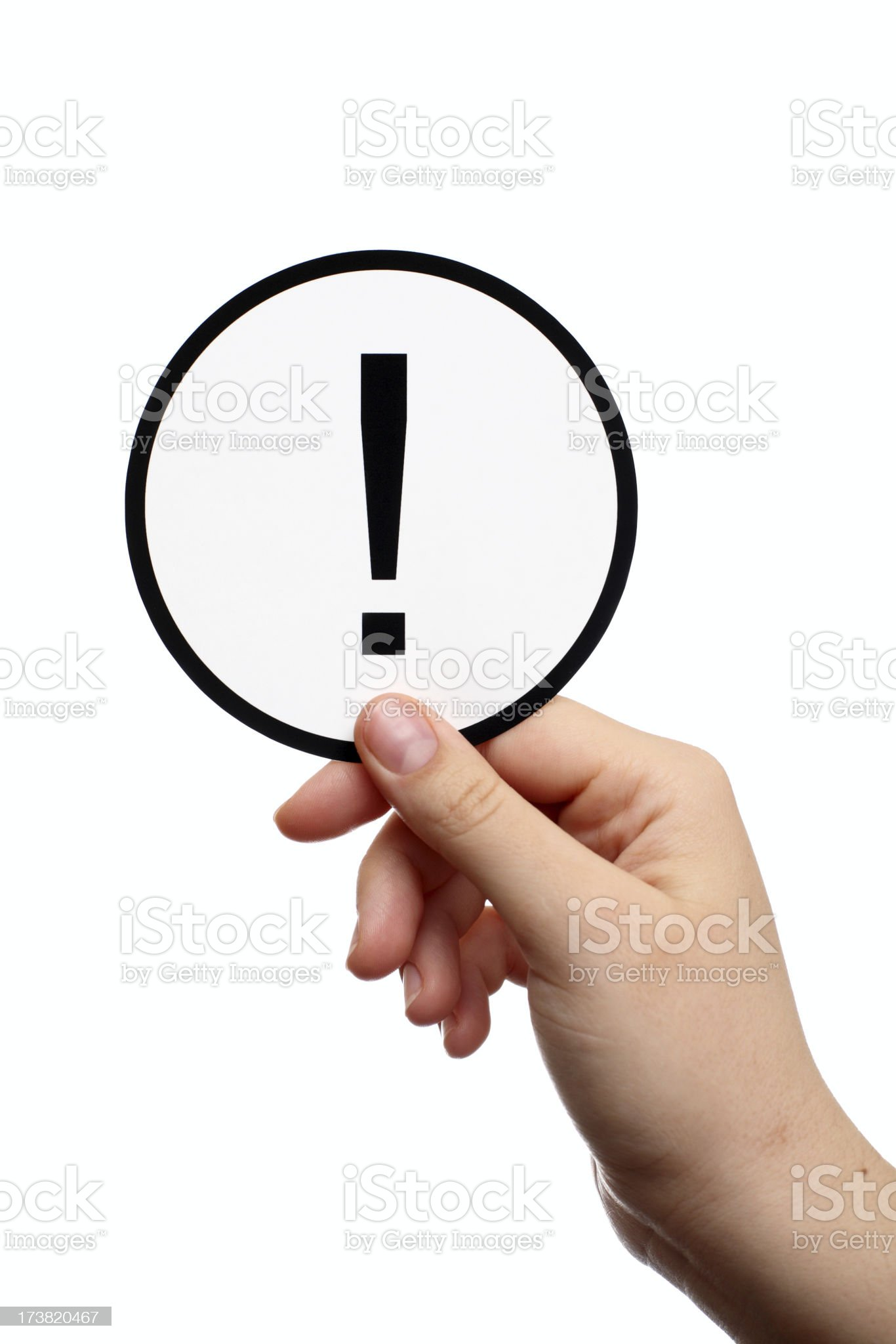 Exclamation mark in hand royalty-free stock photo