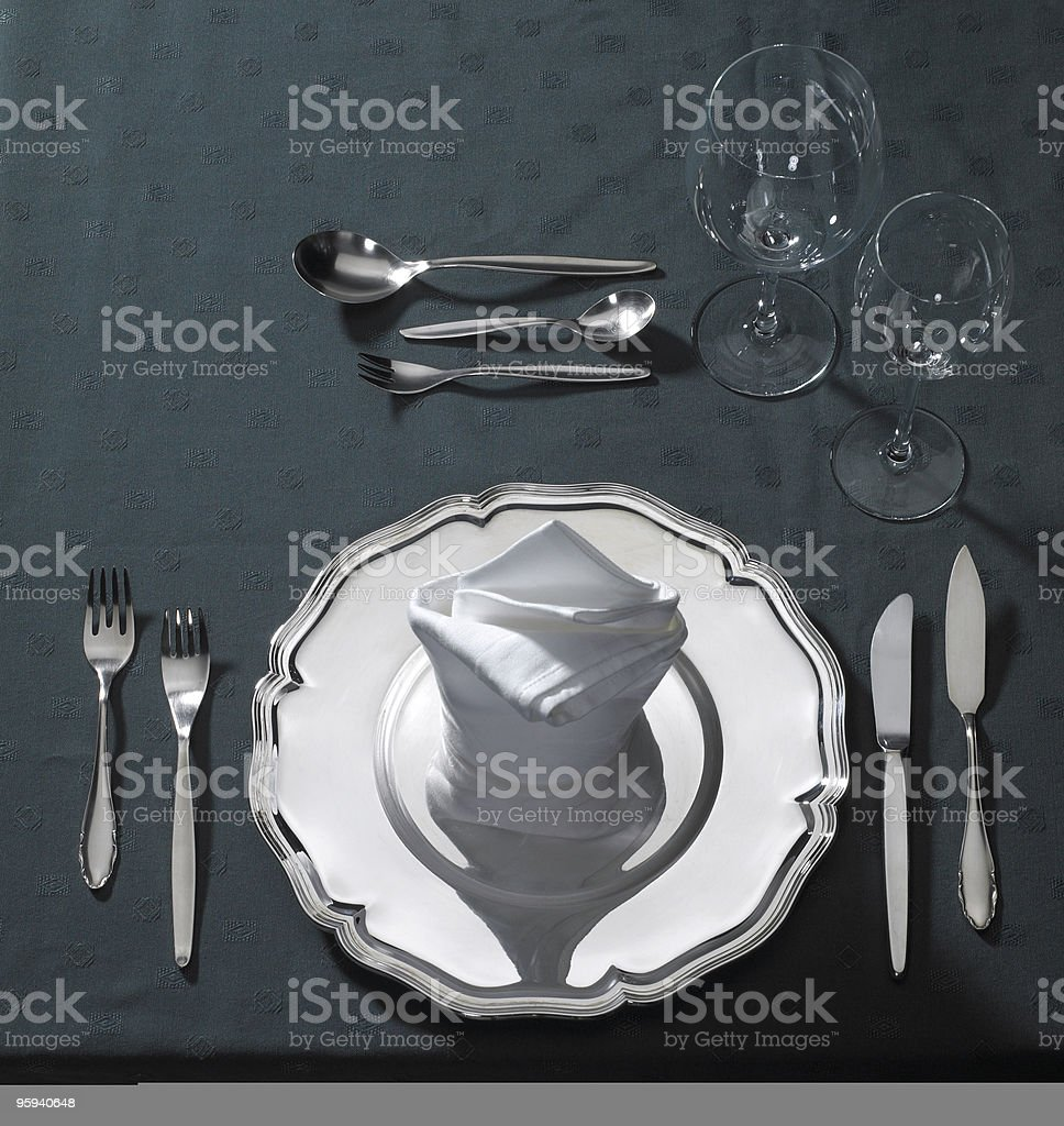 exclusive place setting on dark tablecloth royalty-free stock photo