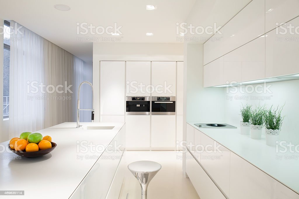 Exclusive white kitchen interior stock photo