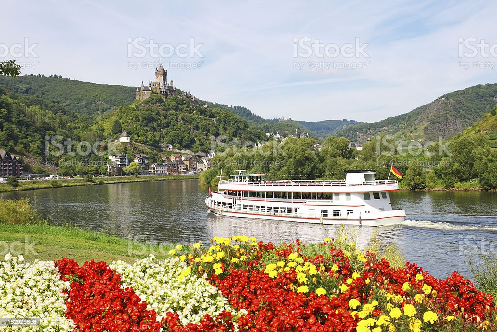 Excursion boat on river Mosel with Reichsburg castle in background stock photo